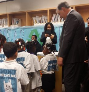 Mayor Mike Rawlings encourages students to recycle.