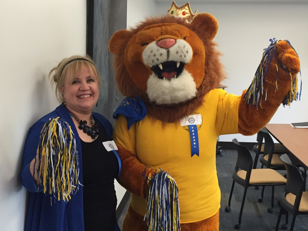 Trini Garza Principal Dr. Janice Lombardi and the Mountain View College mascot celebrate the school's Blue Ribbon award.